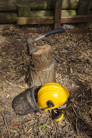 Hand axe and safety hardhat outside in Autumn