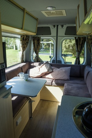 A cup of tea and a cup of coffee in a campervan