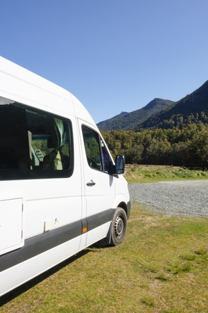 Campervan parked in a wilderness campsite in Fjordland Stock Photo