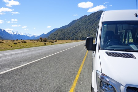 Campervan parked in a laybay on a remote road Stock Photo
