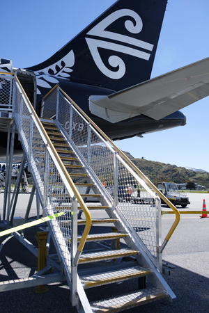 Tail of an Air New Zealand plane and airstair at Queenstown Airport, New Zealand Editorial
