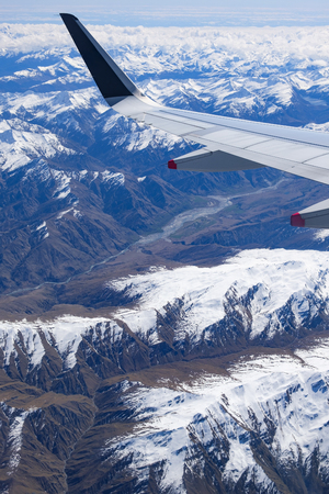 New Zealands South Island, aerial view from commercial airplane inlcuding segement of aircrafts wing