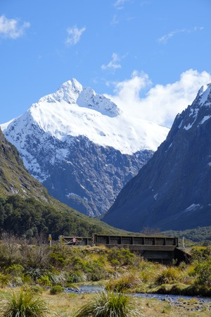 View of bridge and mountains from Monkey Creek, Fjordland, South Island, New Zealand. State Highway 94. Stock Photo