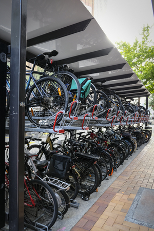 Double storey bike rack in city. Efficient storage and environmentally friendly. Wellington New Zealand 4th March 2019 Editorial