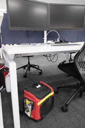 Emergency Grab Bag under an office desk. Earthquake preparedness.