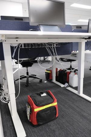 Emergency Grab Bag under an office desk. Stock Photo
