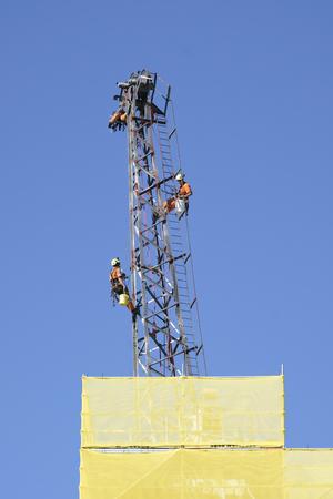 Maintenance on old crane above scaffolding