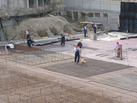Construction site with seeral workers      Stock Photo