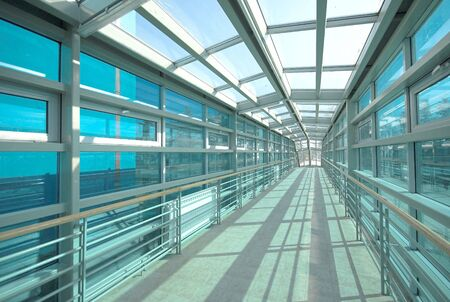 Modern building transparent tunnel - glass corridor