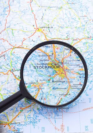 Magnifying glass over the map, focusing on Stockholm