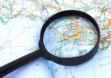 Magnifying glass over the map, focusing on Napoli