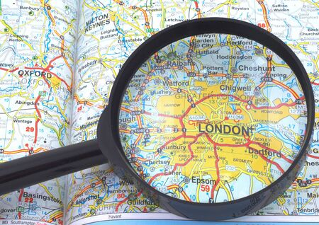 London under magnifying glass on open book Stock Photo