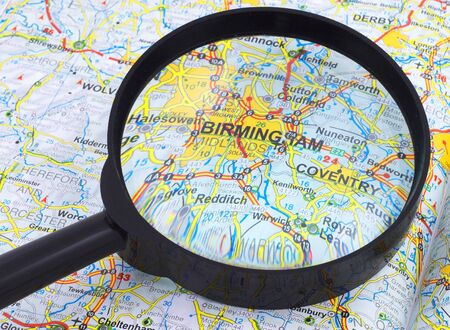 Birmingham under magnifying glass on open book Stock Photo