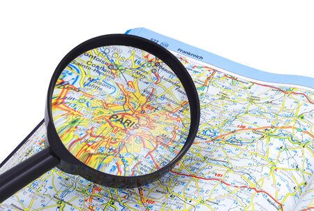 PARIS - FRANCE MAP under magnifying glass on open book photo