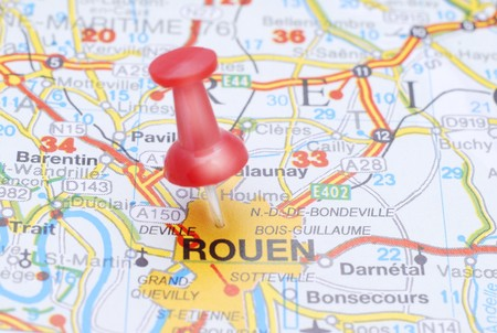 Rouen, France, Europe. Push pin on an old map showing travel destination. Selective focus.