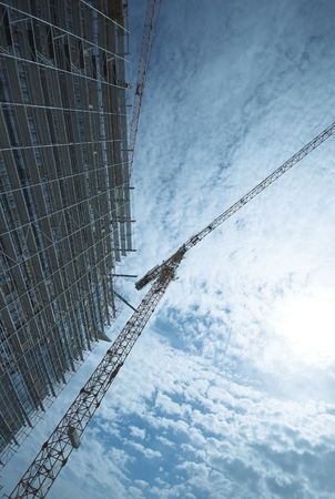 Skyscrapper construction site and light crane Stock Photo - 6485813