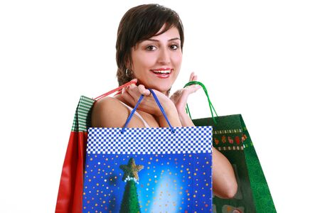Young brunette girl with shopping bags, isolated on white background
