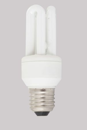 Energy saving light bulb isolated on gray background