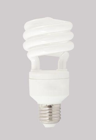 Energy saving light bulb isolated on gray background Stock Photo - 6707714