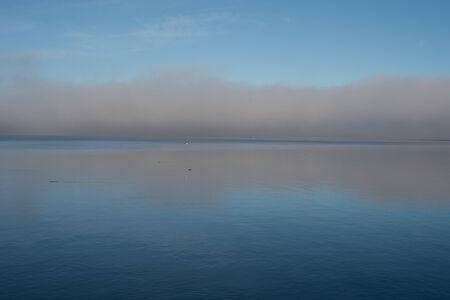 nuances: Fog reflection on sea