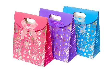 three multi-colored cardboard gift pack with an internal handle Stock Photo - 8987659
