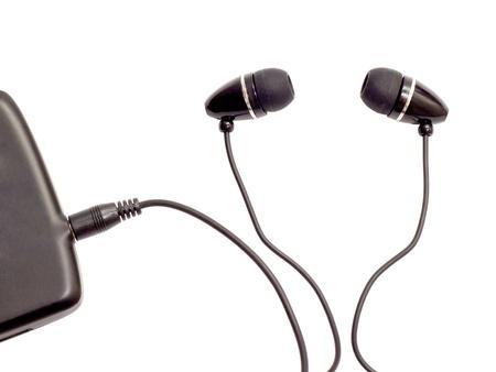 MP3 플레이어에 연결된 휴대용 오디오 헤드폰 스톡 콘텐츠