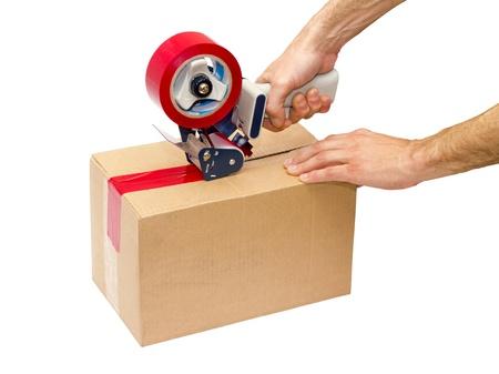 dispensador: Cajas de cart�n pegan dispensador de cinta adhesiva Foto de archivo