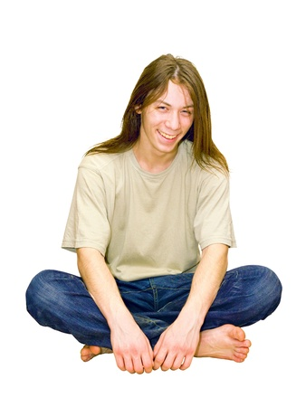 cross leg: portrait of a young gay guy sitting in the lotus position