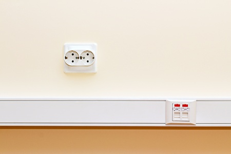 rj45 socket and the socket 220 on the office wall photo