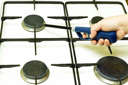 Lighter gas burner ignites the gas stove Stock Photo
