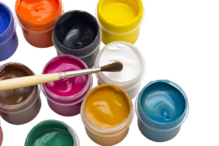 colorful gouache paint and brush isolated on white background photo