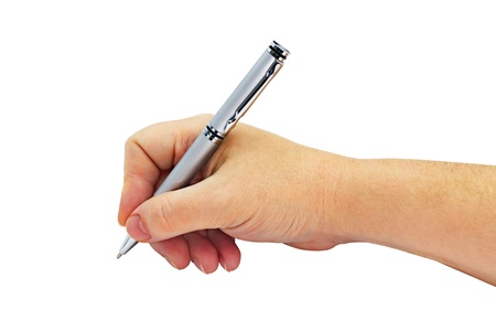 Metallic silver ballpoint pen in a female hand isolated on white background photo