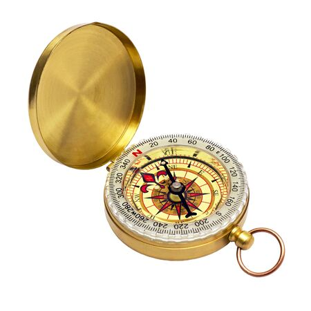 compass in a brass case isolated on white background photo