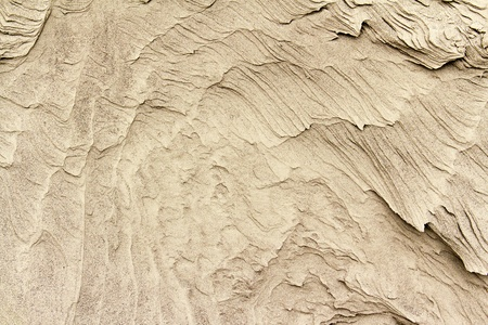 patterns of erosion of sand in the background Stock Photo - 11956646