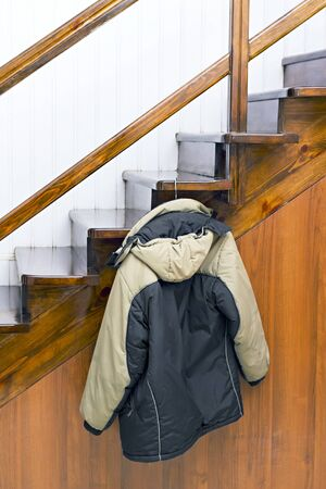 jacket on a hanger hanging on the stairs photo