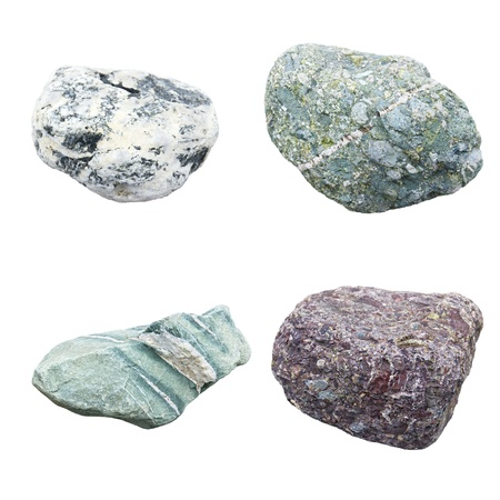 set of four minerals on a white background photo