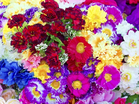 background of colorful artificial flowers photo
