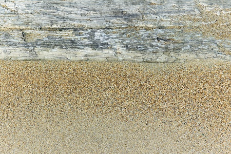 limbering: an old wooden board in the sand as the background