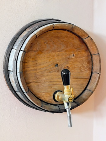 wooden barrel with a tap in the wall of