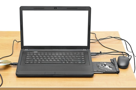 laptop on a table with an open drive isolated on white background photo