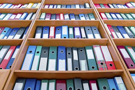 file folders, standing on the shelves in the background Stock Photo - 13928214