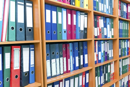 file folders, standing on the shelves in the background Stock Photo