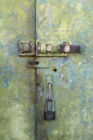 hasp: old iron door with a lock and hasp Stock Photo