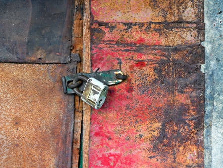 vintagel: Old vintage padlock on the door of the barn Stock Photo