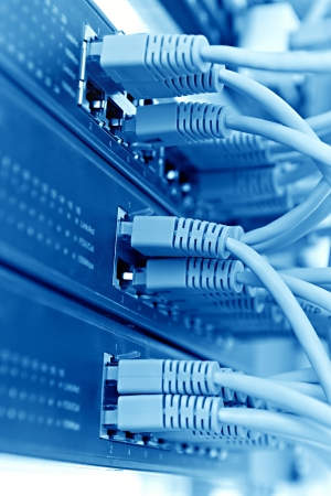 Patch Panel server rack with  cords in the background, blue tone Stock Photo