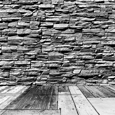 room with a stone wall and wooden floor in grunge style Stock Photo