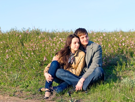 Outdoor Portrait of young couple against the sky photo
