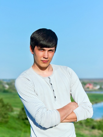 summer portrait of a young man outdoors photo