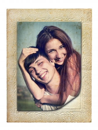 vintage picture in an old cardboard frame of a young couple in love photo