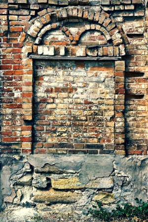 arch of an old brick wall of a house photo